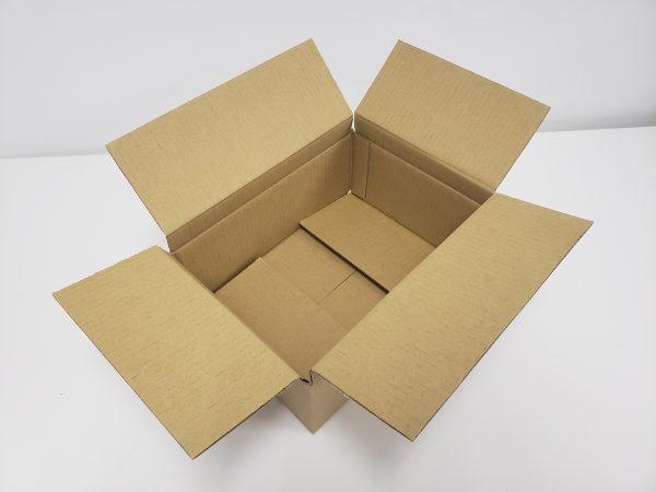 近大図書館様用本を梱包する箱を高さを調整したところ
